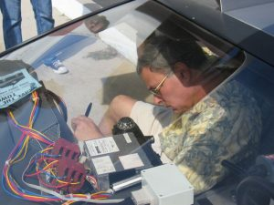Bob Gale signing the BTTF Car DeLorean Time Machine in 2008